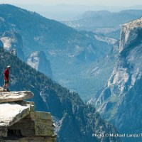 "Hiker on ""The Visor,"" Half Dome, Yosemite National Park, California."