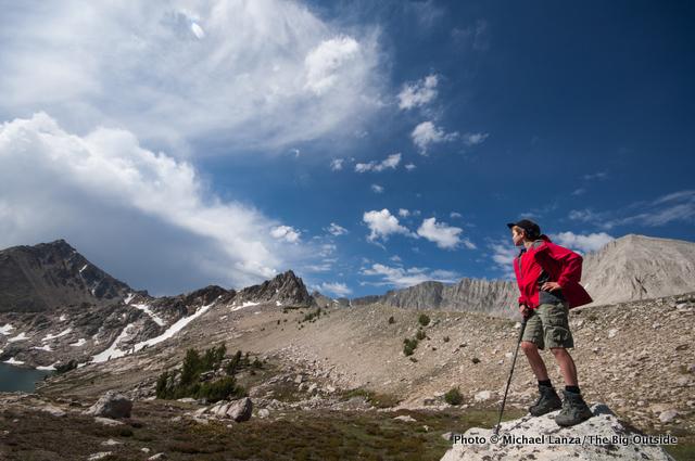 A teenage backpacker below David O. Lee Peak, Big Boulder Lakes, White Cloud Mountains, Idaho.