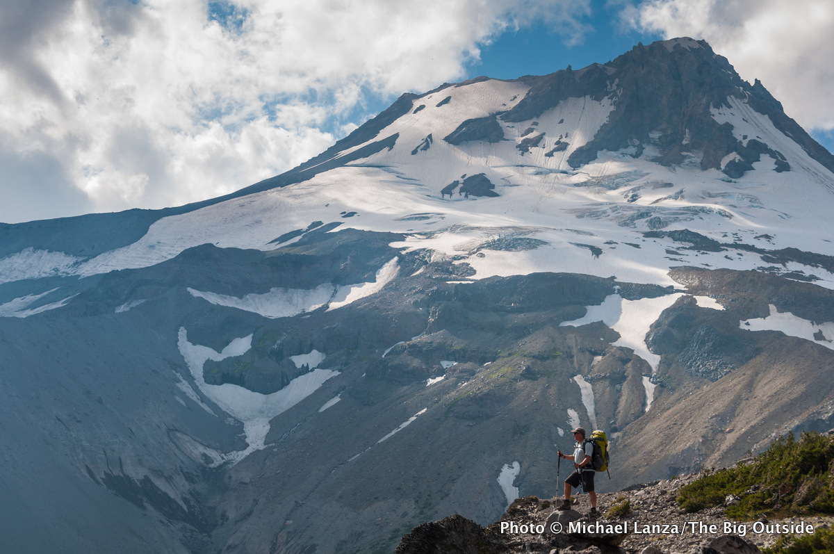 A backpacker on Gnarl Ridge along the 41-mile Timberline Trail around Mount Hood, Oregon.