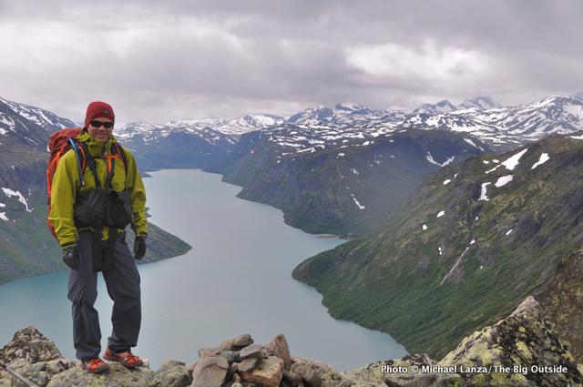 Michael Lanza of The Big Outside trekking Besseggen Ridge, above Lake Gjende, in Norways Jotunheimen National Park.