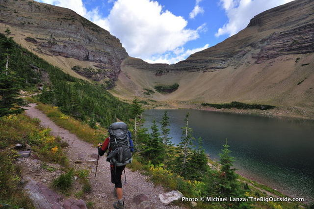A backpacker at Ptarmigan Lake, Ptarmigan Tunnel Trail, Glacier National Park.