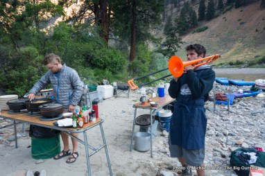 Guides Henry cooking, Topher playing, at Whitie Cox camp.