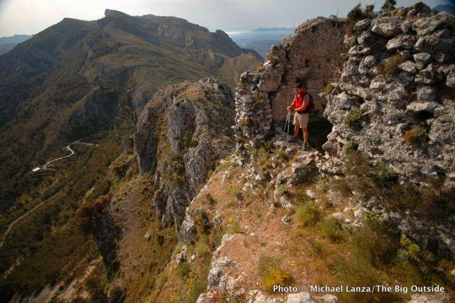 Trekking past castle ruins in Spain's Aitana Mountains.