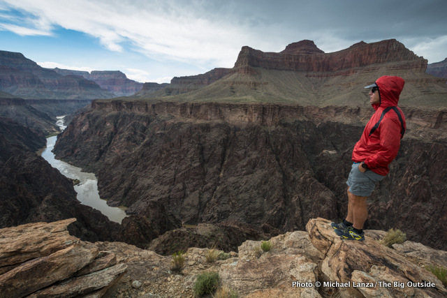 David Ports enjoys the view during a light shower on a 25-mile dayhike in the Grand Canyon.