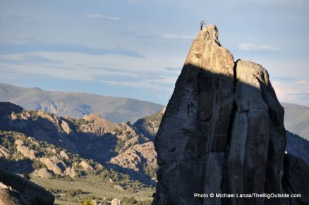 Rock climber atop The Incisor, City of Rocks National Reserve.