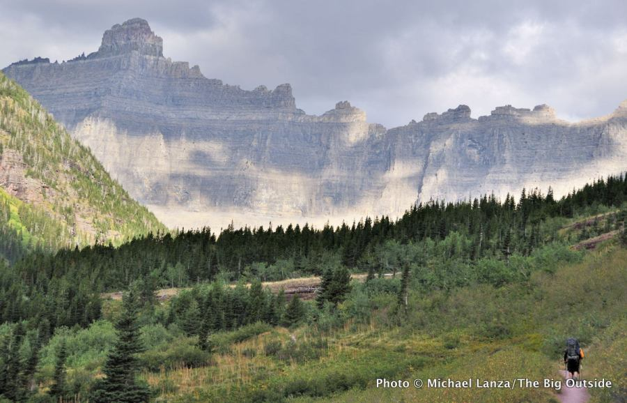 A backpacker on the Ptarmigan Tunnel Trail in Glacier National Park.