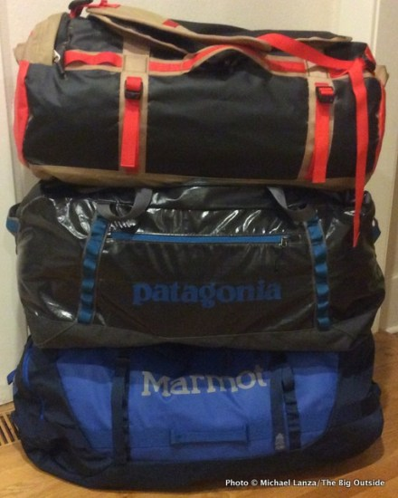 The North Face, Patagonia, and Marmot gear duffels.