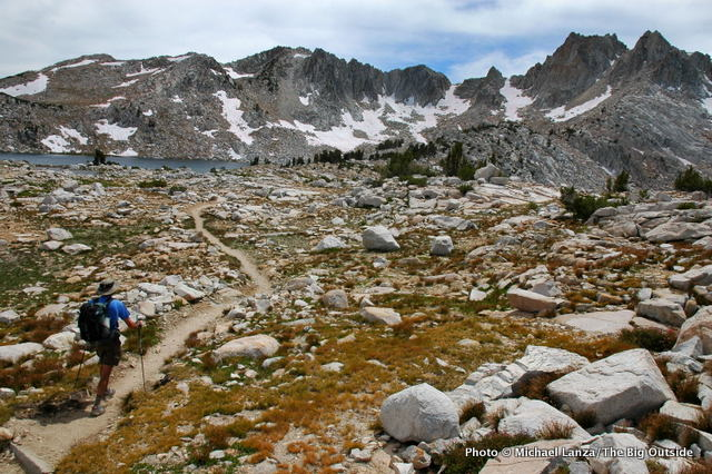 An ultralight backpacker approaching Silver Pass on the John Muir Trail in California's John Muir Wilderness.