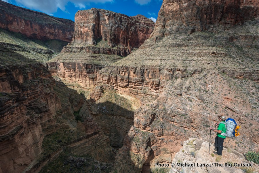 A backpacker above Royal Arch Canyon on the Grand Canyon's Royal Arch Loop.