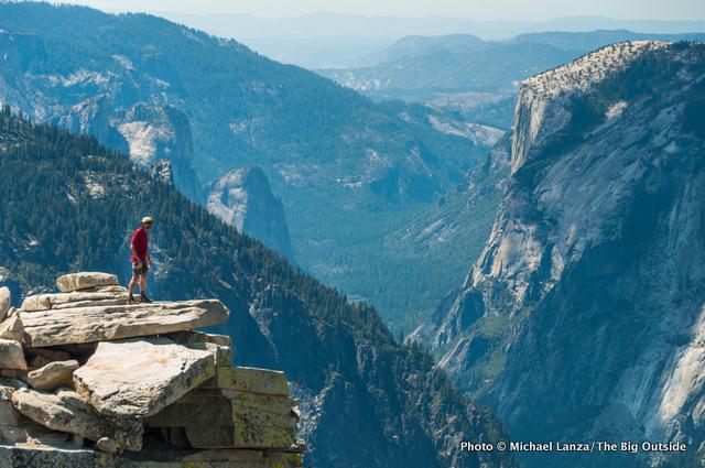 Mark Fenton atop Half Dome, high above Yosemite Valley.