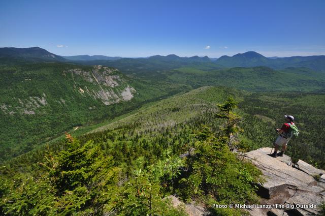 A hiker at Zeacliff, overlooking the Pemigewasset Wilderness, White Mountains, N.H.