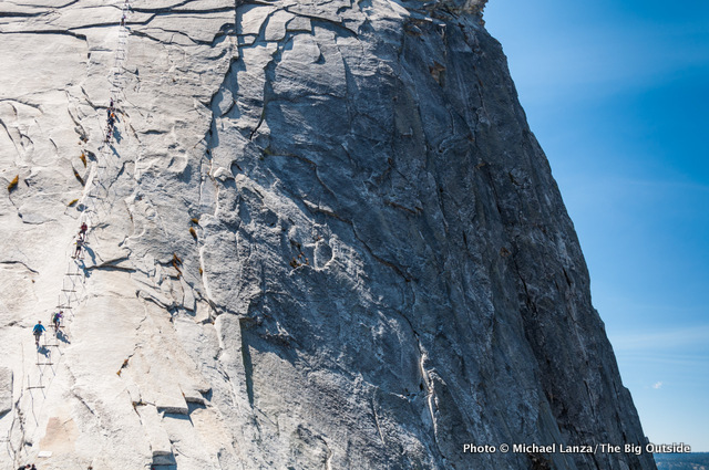 Hikers on Half Dome's cable route, Yosemite National Park.