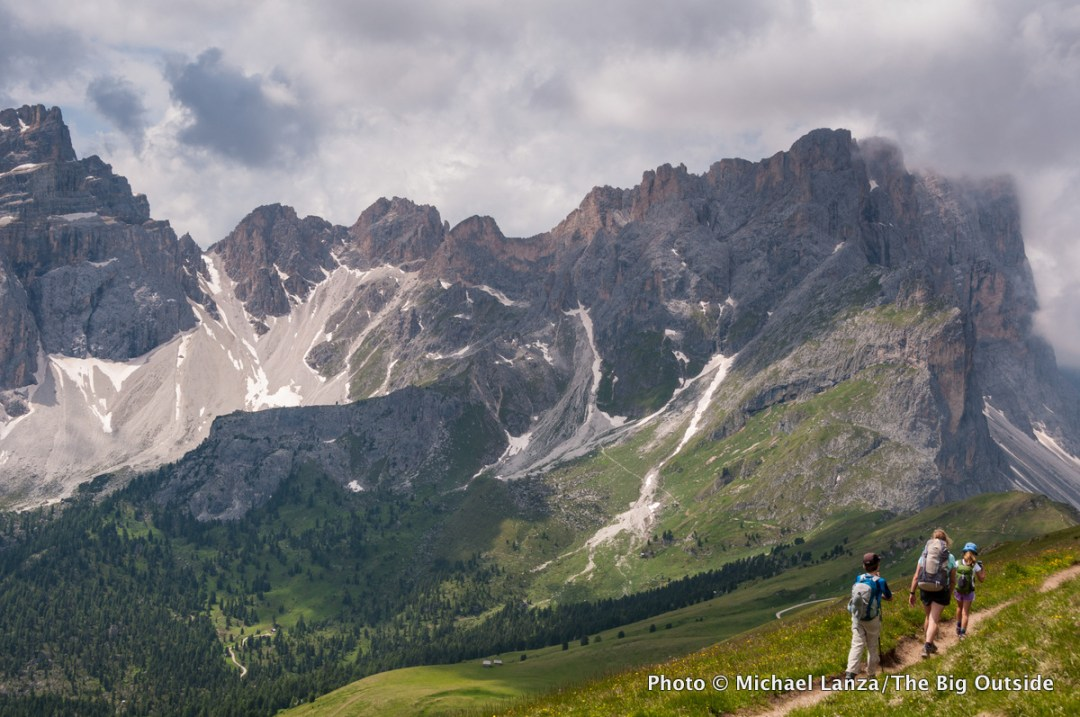 A family hiking to Furcela dia Roa on the Alta Via 2 in Parco Naturale Puez-Odle, Dolomite Mountains, Italy.