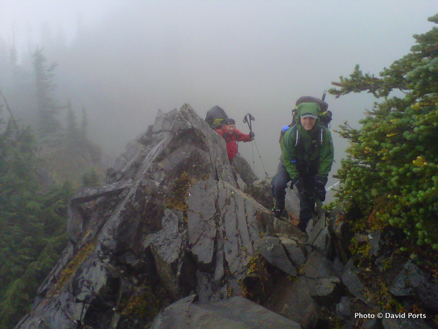Backpackers on a rainy day in the Bailey Range, Olympic National Park.