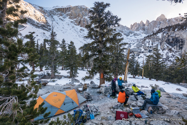 Wearing puffy jackets in camp at 10,300 feet below California's Mount Whitney.
