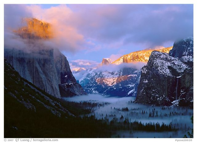 Fog in valley and peaks lit by a winter sunset, Yosemite National Park.