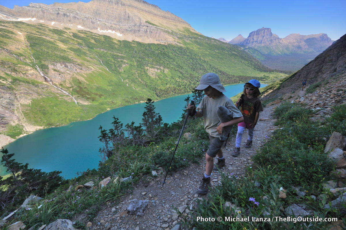 Young kids hiking the Gunsight Pass Trail in Glacier National Park.