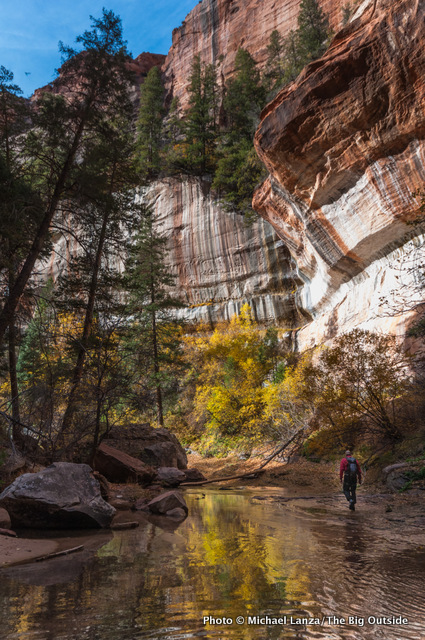 A hiker exiting the lower end of the Subway in Zion National Park.