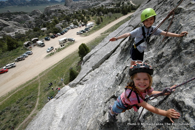 Young kids rock climbing at Idaho's City of Rocks National Reserve.