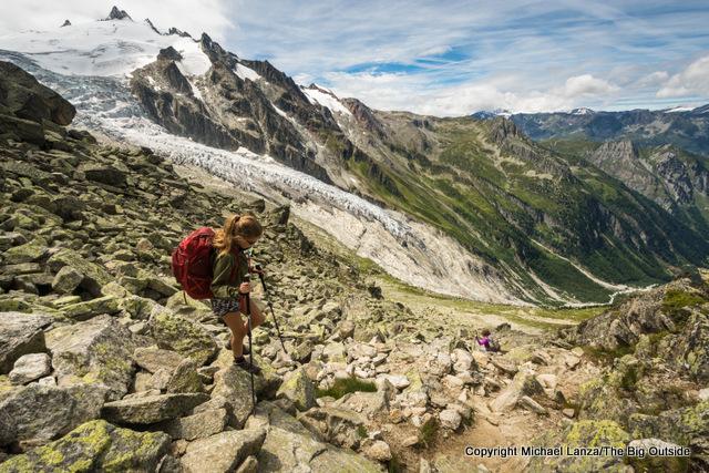 A hiker descending from the Fenetre d'Arpette on the Tour du Mont Blanc.