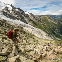 A hiker descending from the Fenetre d'Arpette on the Tour du Mont Blanc.
