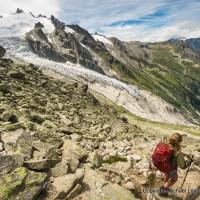 A hiker descending off the Fenetre d'Arpette on the Tour du Mont Blanc in Switzerland.