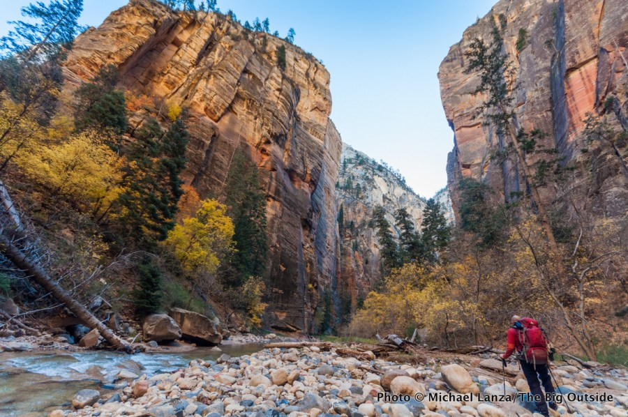 A backpacker in The Narrows in Zion National Park.