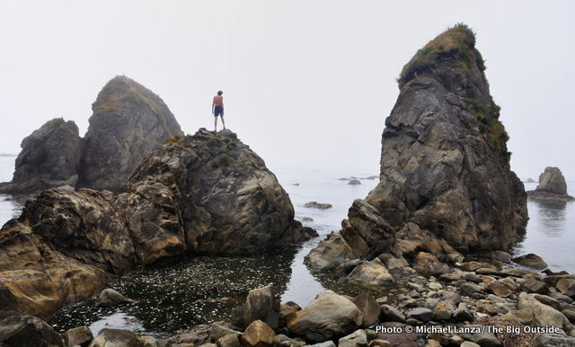 A backpacker at Toleak Point, Olympic National Park.