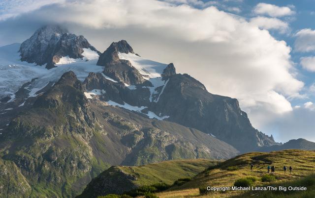 Trekkers hiking to the Col de la Seigne, Tour du Mont Blanc, France.