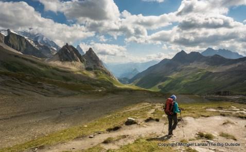 A trekker at the Col de la Seigne on the Tour du Mont Blanc.