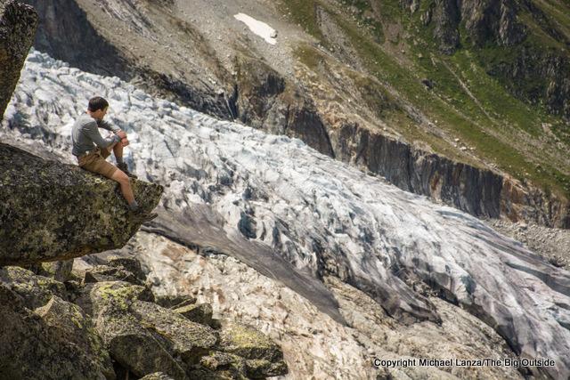 A hiker at the Fenetre d'Arpette, Tour du Mont Blanc, Switzerland.
