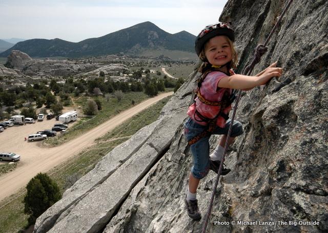 Young girl rock climbing at Idaho's City of Rocks National Reserve.