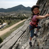 Young girl rock climbing at Idaho's City of Rocks National Reserve.