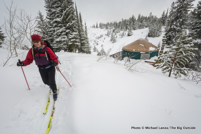 Cross-country skier heading out from a yurt, Boise National Forest, Idaho.