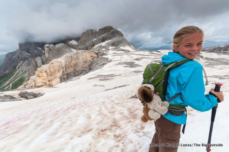 Young girl trekking in Parco Naturale Paneveggio Pale di San Martino, Dolomite Mouintains, Italy.