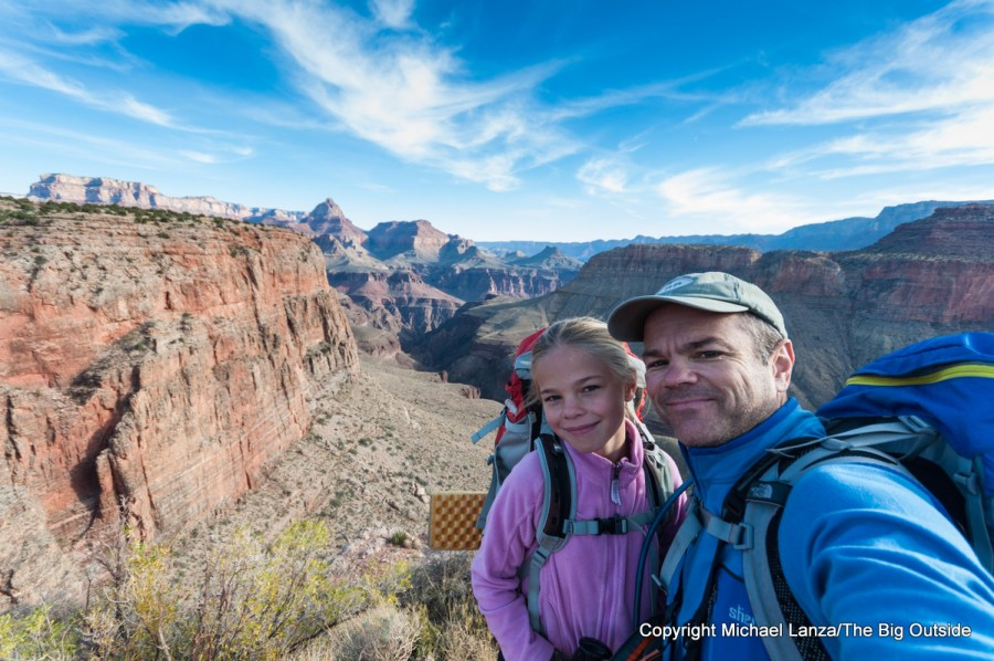 Young girl and father backpacking in the Grand Canyon.