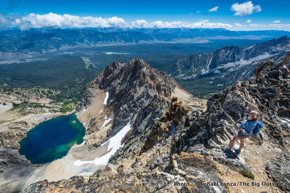 A hiker near the summit of 10,751-foot Thompson Peak, the highest peak in Idaho's Sawtooth Mountains.