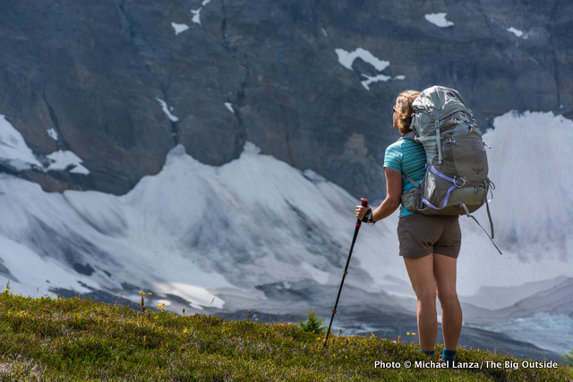 A woman backpacker on the Rockwall Trail, Kootenay National Park, Canada.