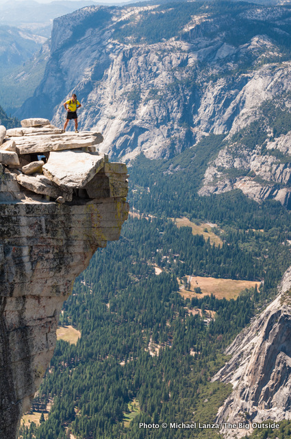 """A hiker on """"The Visor"""" of Half Dome in Yosemite."""