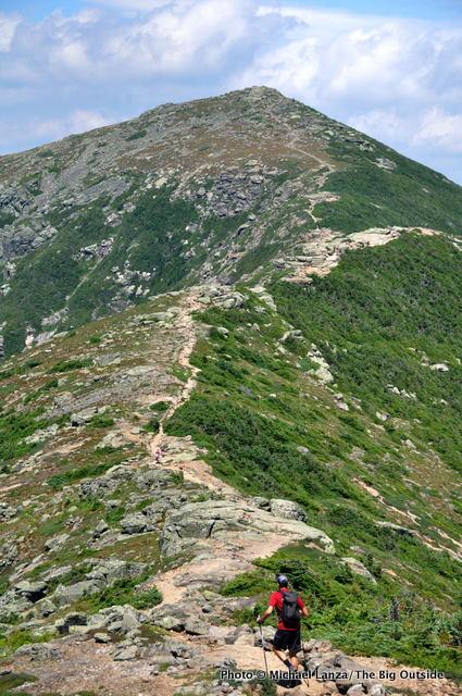 A hiker on the Appalachian Trail on Franconia Ridge, White Mountains, N.H.
