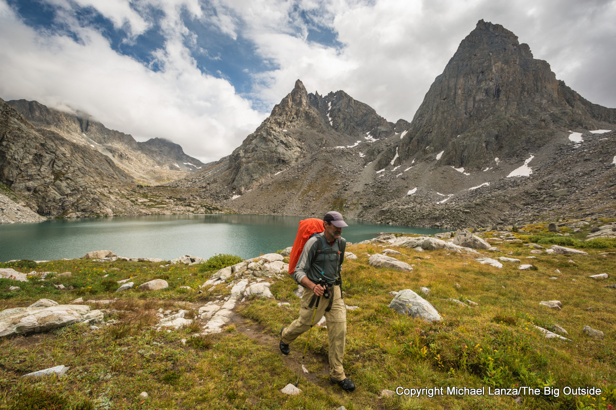 A backpacker on the Shannon Pass Trail above Peak Lake, Wind River Range, Wyoming.