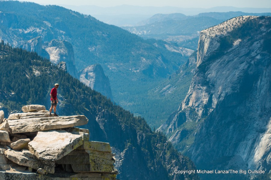 A hiker atop Half Dome in Yosemite National Park.