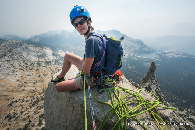Young rock climber on the summit of Cathedral Peak in Yosemite National Park.