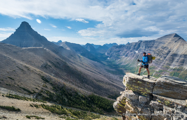 Backpacker hiking from Pitamakan Pass to Dawson Pass in Glacier National Park.