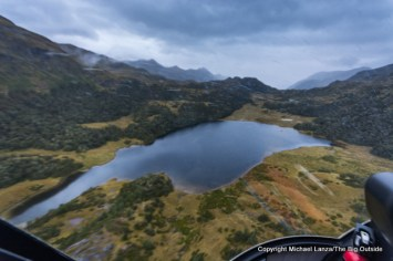 View from the helicopter while flying to Lake Roe Hut on the Dusky Track in Fiordland National Park, New Zealand.