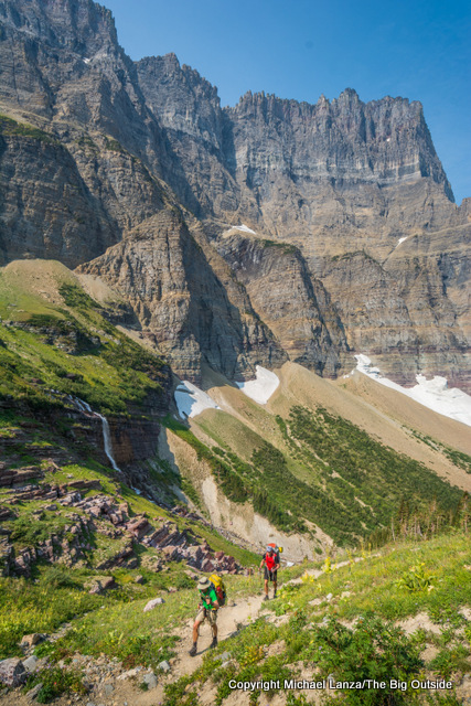 Morning Eagle Falls and backpackers on the Piegan Pass Trail in Glacier National Park.
