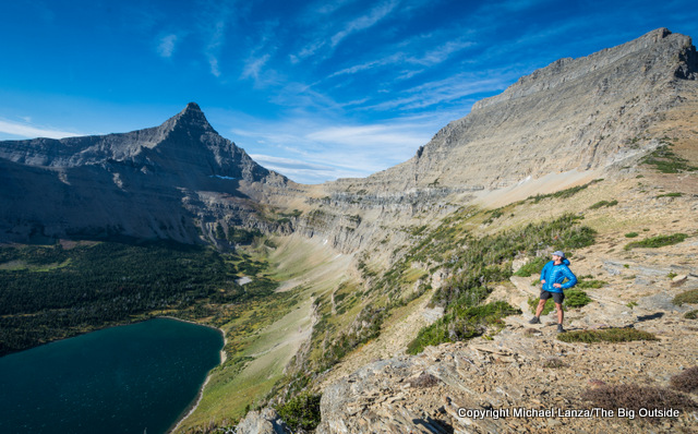 A hiker at Pitamakan Pass in Glacier National Park.