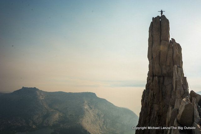 Rock climber atop Eichorn Pinnacle in Yosemite National Park.