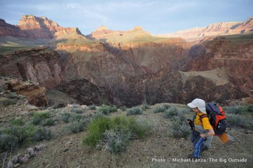 A young boy backpacking the Grand Canyon's Tonto East Trail.