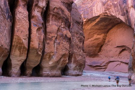 Backpackers in the narrows of Paria Canyon, in southern Utah and northern Arizona.